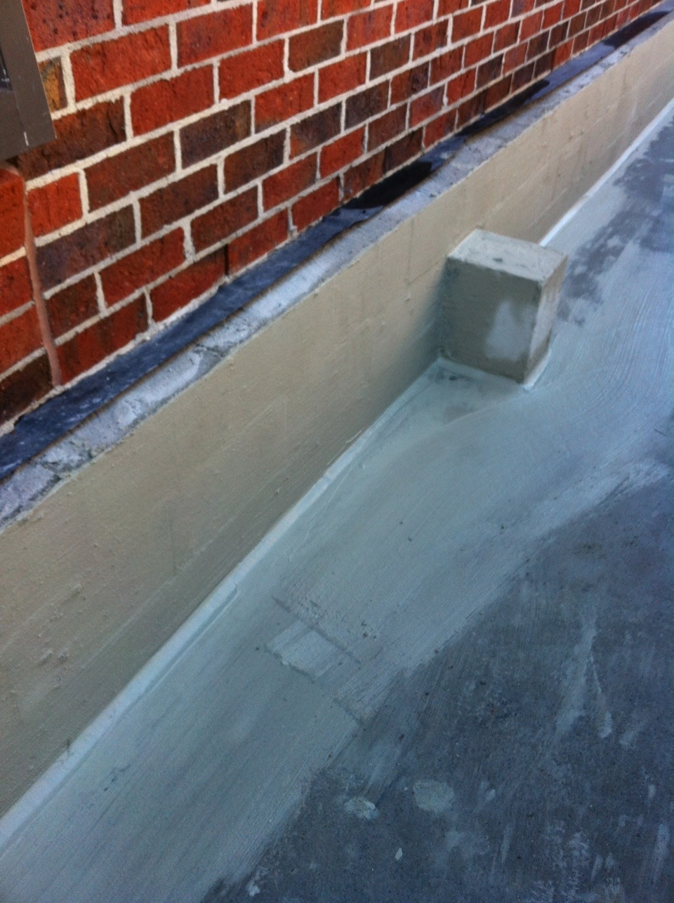 Rendered wall prior to waterproofing application