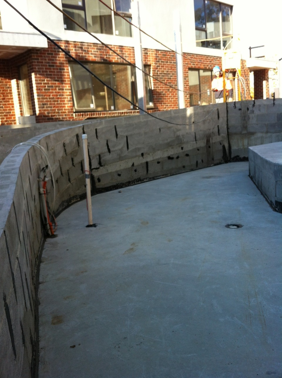 Retaining wall preparation before waterproofing